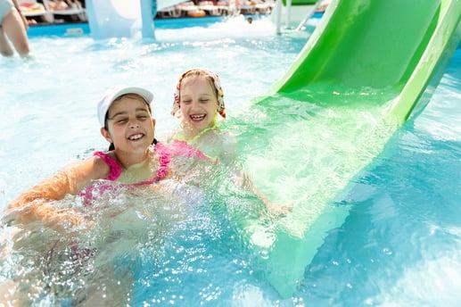 bigstock-Two-Girls-Splash-In-An-Outdoor-427259528