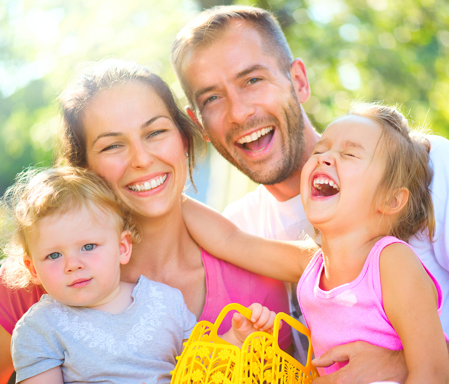 bigstock-Happy-joyful-young-family-with-144647294